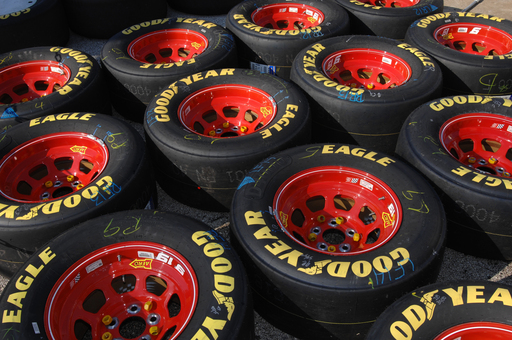 Goodyear Eagle racing tires are lined up and ready to race. The Goodyear Tire & Rubber Company is the exclusive tire supplier to NASCAR's Sprint Cup, Nationwide and Camping World Truck Series.