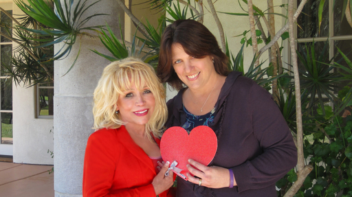 Irene Valenti of Valenti International presents Valentine to Suzanne Wells of Empty Cradle charity