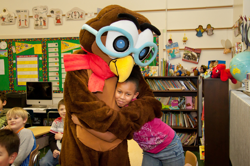 Racine Reads: Dream Big! mascot Booker the Owl visits students during One Book, One Grade, One Community Event on January 23, 2012