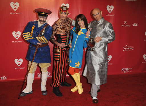 Castmembers from the Beatles ''LOVE'' by Cirque du Soleil arrive at The 2012 MusiCares Person of The Year Gala Honoring Paul McCartney at Los Angeles Convention Center on February 10, 2012 in Los Angeles, California.  (Photo by Steve Granitz/WireImage)