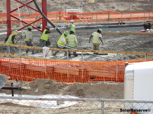 Construction workers fill the foundation of the SolarReserve Crescent Dunes Solar Energy Plant power tower with concrete.