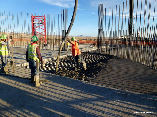Construction workers complete final stage of the foundation concrete pour of the SolarReserve Crescent Dunes Solar Energy Plant power tower with concrete.
