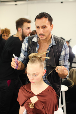 John Frieda Global Creative Consultant applies Frizz-Ease Sheer Solution at Zac Posen' 2012 New York Fashion Week show
