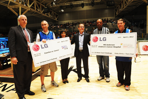James Fishler, senior vice president of marketing for LG Electronics USA, presents total donation of $20,000 to Coaches vs. Cancer and MD Anderson Children's Cancer Hospital in the names of Hurley and Ford at Bracket Town.