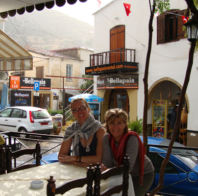 "Stocke (left) and Brenner in Bellapais, (Turkish) Cyprus, at the cafe under ""The Tree of Idleness,"" named by Lawrence Durrell in his book Bitter Lemons."