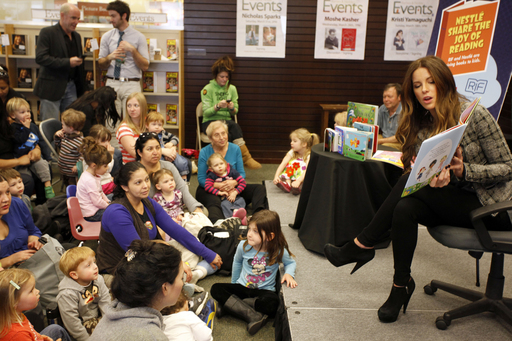 "Kate Beckinsale reads to children for ""The Nestlé Share the Joy of Reading Program"" at Barnes & Noble at The Grove in Los Angeles on Thursday, March 1, 2012. (Joe Kohen/AP Images)"