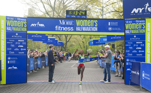 First-place winner, Alemtsehay Misganaw crosses the finish line  at the 9th Annual More Magazine/Fitness Magazine Women's Half Marathon with a new course record of 1:13:25.