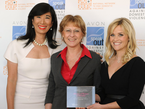 Andrea Jung and Reese Witherspoon present an Avon Global Believe Fund grant to Katarina Farkašová, director of Slovakia's Alliance of Women.
