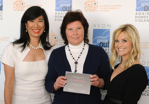 Andrea Jung and Reese Witherspoon present an Avon Global Believe Fund grant to Kateryna Levchenko, president of the Ukraine's International Women Rights Centre – La Strada.