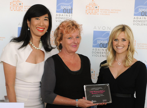 Andrea Jung and Reese Witherspoon present an Avon Global Believe Fund grant to Catherine Gander, CEO, of Australia's NSW Women's Refuge Resource Centre.