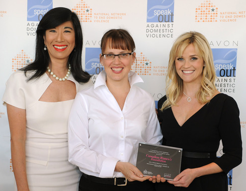 Andrea Jung and Reese Witherspoon present an Avon Global Believe Fund grant to Kathryn Babcock, vice president of strategic initiatives, of The Canadian Women's Foundation.