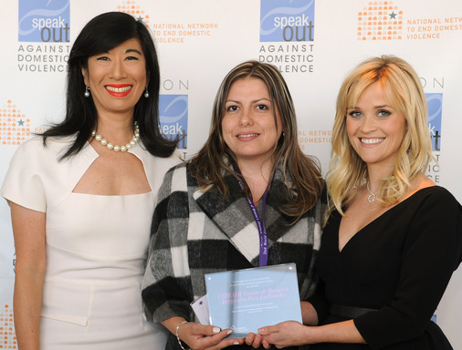 Andrea Jung and Reese Witherspoon present an Avon Global Believe Fund grant to Milena Mesa Gallego, a psychologist with Colombia's Cerfami.