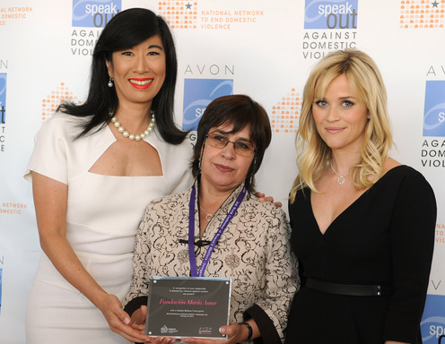 Andrea Jung and Reese Witherspoon present an Avon Global Believe Fund grant to Marlene Villavicencio, director of Ecuador's Maria Amor Foundation.