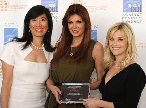 Andrea Jung and Reese Witherspoon present an Avon Global Believe Fund grant to Mada Tsagias-Papadakou, president of Greece's W.I.N. Hellas.