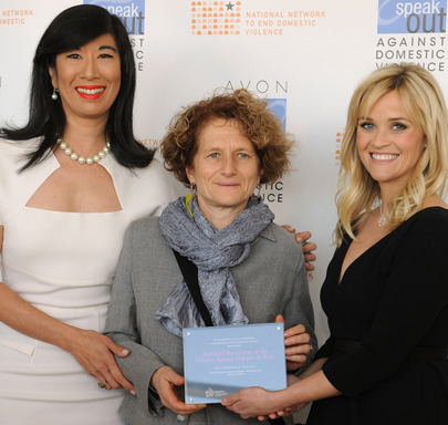 Andrea Jung and Reese Witherspoon present an Avon Global Believe Fund grant to Marcella Pirrone, a board member of Italy's Donne In Rete Contro la Violenza.