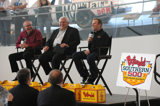(L to R) Darlington Raceway's Chris Browning and Bojangles' Randy Kibler look on as NASCAR driver Regan Smith shares his anticipation of the new Bojangles' Southern 500.