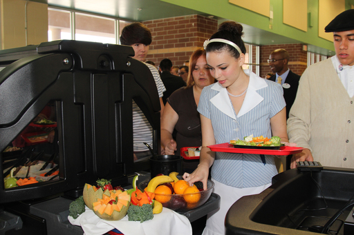 "Students at Oviedo High School choosing fresh fruits and vegetables at their newly donated salad bar as part of the""Let's Move Salad Bars to Schools"" initiative"