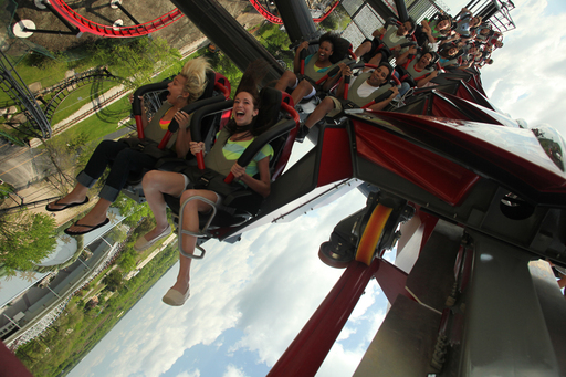 Riders plunge towards the ground upside down nearly 120 feet in the air.