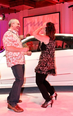 L'Auberge Lake Charles guests dance in celebration after receiving leases on Mercedes-Benz convertibles, part of Pinnacle Entertainment's enhanced mychoice loyalty program for its gaming customers.