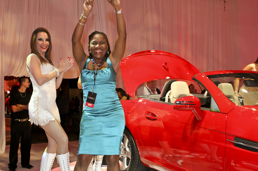 A Pinnacle Entertainment Owner's Club member celebrates earning an annual lease on a Mercedes-Benz convertible as part of the enhanced mychoice guest loyalty program unveiled by the gaming company.