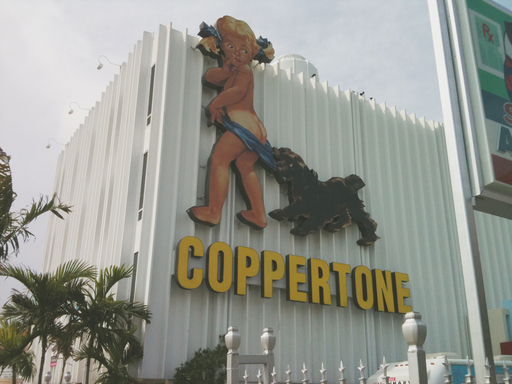After a storm destroyed the original billboard, the Little Miss Coppertone sign was restored with energy-saving LED lights and re-installed in Miami's historic MiMo district in 2008.