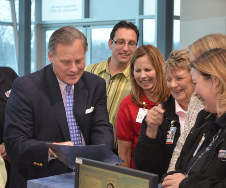 Sen. Richard Burr (R-NC) with NASCAR Tech employees during a campus tour.