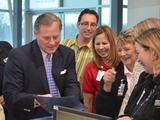 55971-sen-burr-laughs-with-nti-staff-sm