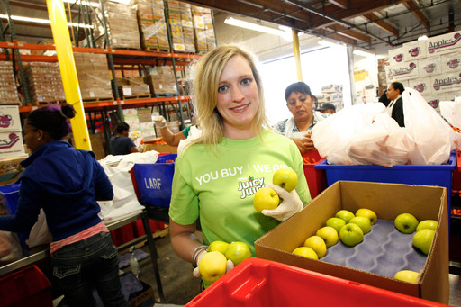 Photo courtesy of Nestle USA, Maura Daly, Chief Communications Officer at Feeding America, Volunteers at the Launch of the Nestle Juicy Juice Fruit for All Project at the Los Angeles Regional Food Bank on Thursday, May 31, 2012