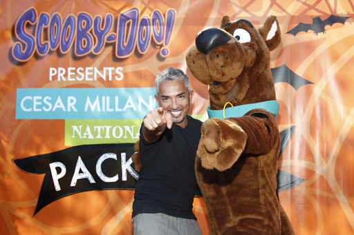 Cesar Millan and Scooby-Doo come together for the National Family Pack Walk Event.