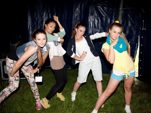 The winners of the 2012 Summer Dance competition, FORCE OUT, strike a pose before taking the stage