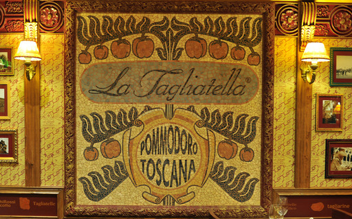 La Tagliatella logo on the restaurant's wall