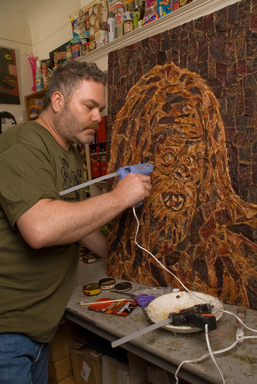 Mosaic artist Jason Mecier uses a steady hand to finalize his latest creation made entirely of Jack Link's Jerky