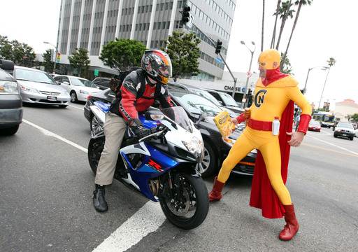 The Crunchy Nut, the newest Kellogg's character, breaks the morning traffic routine by distributing Kellogg's Crunchy Nut cereal to L.A. drivers in his mission to bring fun back to breakfast on Tuesday June 12, 2012 in Los Angeles. (Photo by Casey Rodgers