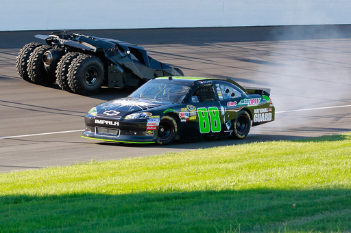 The No. 88 Diet Mtn Dew/The Dark Night Rises Chevy does donuts around the iconic Batman Tumbler on the front stretch in Michigan