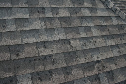Random hail hits to composition shingles.