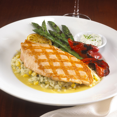 Grilled Alaskan Wild Copper River Salmon – served over summer corn risotto with roasted asparagus, grilled red peppers and dill mustard sauce