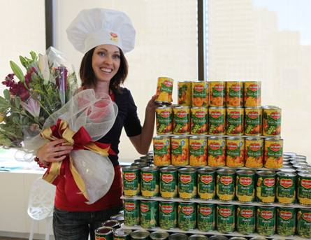 Del Monte Crown the Cook Champion Carmell Childs shows off her year's supply of Del Monte Canned products, which she will receive courtesy of Del Monte