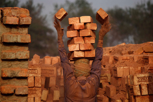 ''Brick Worker'' by Moksumul Haque, Bangladesh. Regional Winner, South Asia. A private enterprise worker is working at a brick field. Small businesses create new jobs for many poor people.