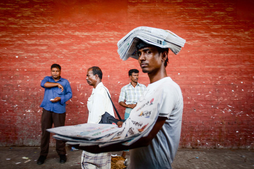 ''Paperman'' by Md Farhad Rahman, Bangladesh. Second Prize. This man earns an income selling daily papers in a railway station. Selling papers is a common form of self-employment in Bangladesh.
