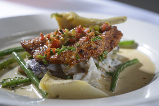 "Roasted red fish  prepared by Certified Master Chef James Hanyzeski at ""A Celebration of America's Best Seafood"" dinner at the historic Woodland Plantation in Plaquemines Parish"