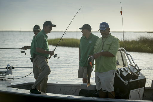 Chefs from The Culinary Institute of America catch red fish off Louisiana's coast in Plaquemines Parish.