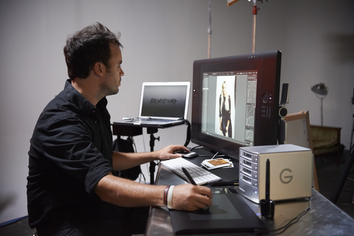Cowart at his workstation where he puts the finishing touches on photos from the shoot with Laura Bell Bundy.