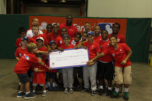 Phillies star Ryan Howard joins State Farm® in presenting Kansas City-area Boys & Girls Clubs with a $5,000 donation following a morning of providing professional hitting tips to local kids and media.