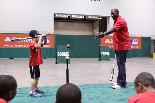 Phillies slugger Ryan Howard shares expert hitting tips with kids from Kansas City-area Boys & Girls Clubs during a baseball clinic hosted by State Farm® prior to the 2012 State Farm Home Run Derby.