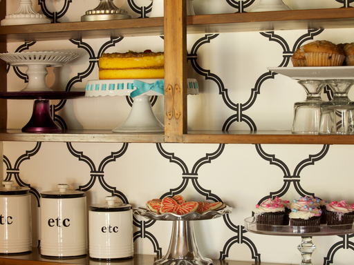 For a fresh look to brighten up the kitchen, remove cabinet doors and add wallpaper in a bright color or fun pattern to the back walls to showcase your personal style in the kitchen