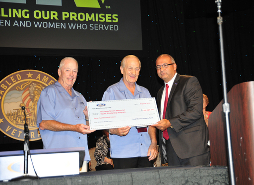 Jim Vella of Ford presents a donation to Donald Samuels & Arthur Wilson of DAV.