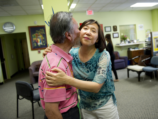 At adult day care, Charles Kao shows his affection for Ruby Ai. Charles, who is living with Alzheimer's, was a 2009 Nobel Prize winner in physics.
