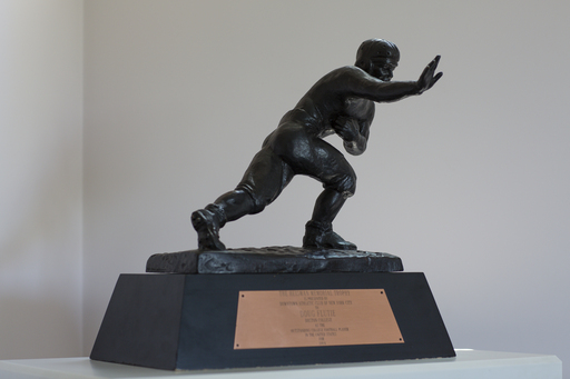 "A look inside the home of Doug Flutie at his Dove® Men+Care® ""Journey to Comfort"" commercial shoot: his Heisman Trophy."