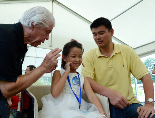 August 26, 2012, Starkey Hearing Foundation China (Chengdu) Mission - Girl receives the gift of hearing with Bill Austin, Founder, Starkey Hearing Foundation (left) and NBA Legend Yao Ming (right).