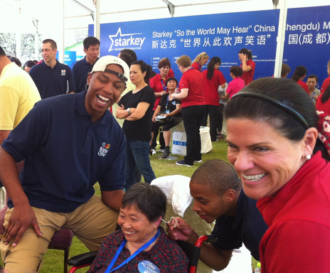 August 26, 2012– NBA Player, Caron Butler (left) and Tani Austin, Founder, Starkey Hearing Foundation (right) celebrate as woman receives the gift of hearing during China Mission.